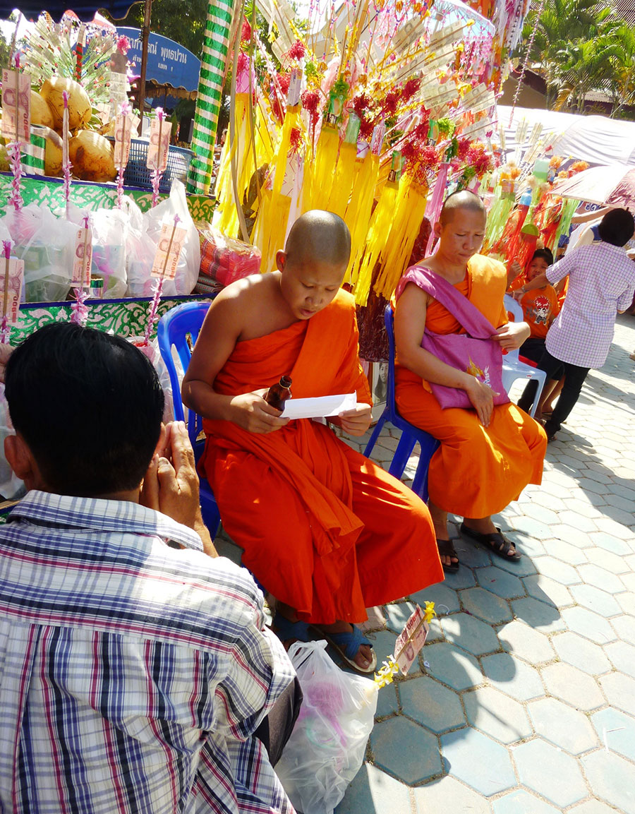 After the names have been found, a monk reads and blesses.