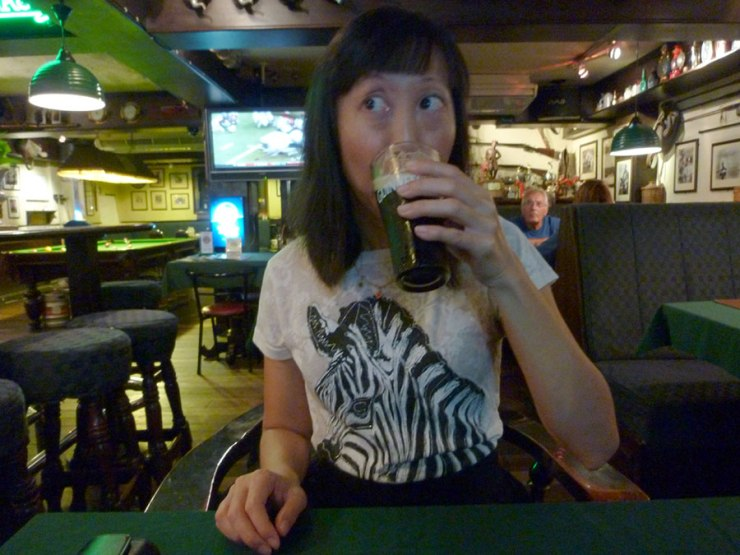 Asian American woman drinking beer