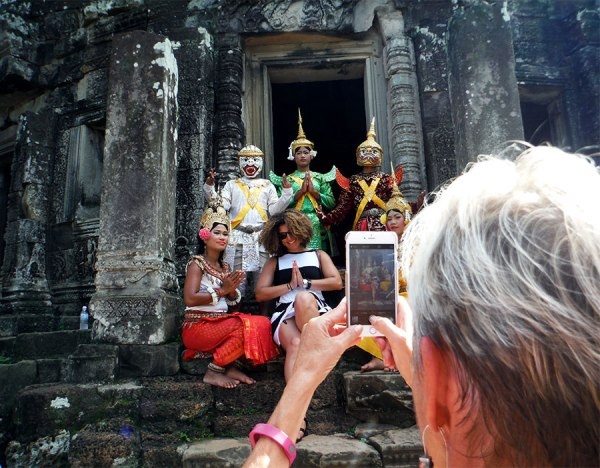 Performers and tourists at Bayon at Angkor Archaeological Park