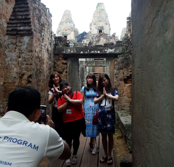 Chinese tourists pose in Angkor Wat