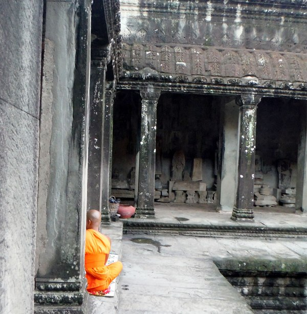 Angkor wat monk waiting to give blessings.