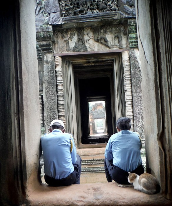 Staff at Banteay Kdei taking it easy while it rains.
