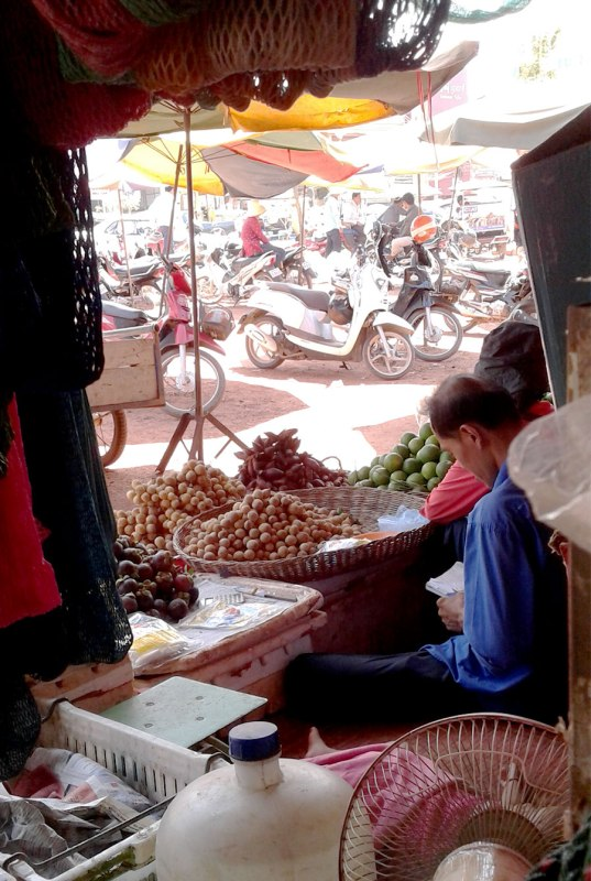 Man reading at Psar Leu Market in Siem Reap