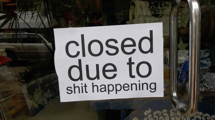 closed to due to shit happening sign