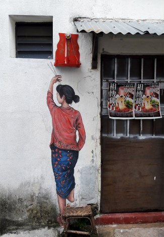 woman-reaching-street-art-penang