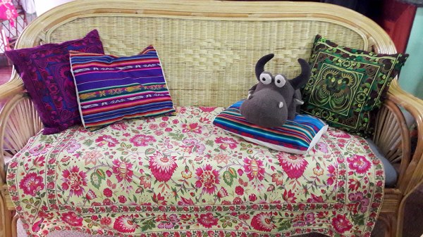 ratan couch with pretty pillows and buffalo