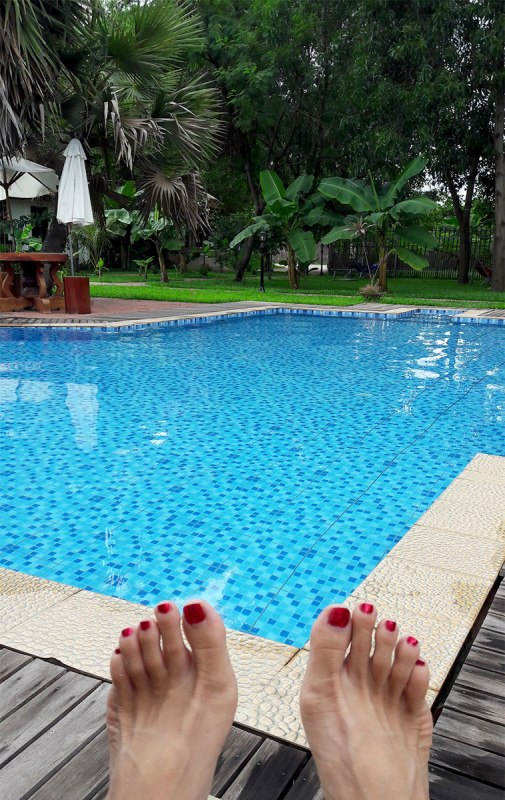 Fancy feet poolside at Angkor Heart Bungalows, Siem Reap, Cambodia