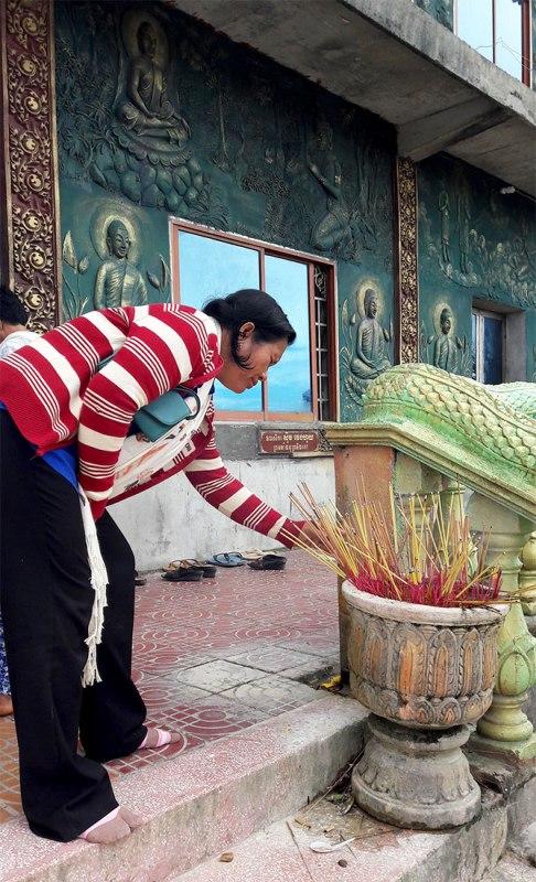 """Making merit"" at Bokor Mountain pagoda, Kampot"